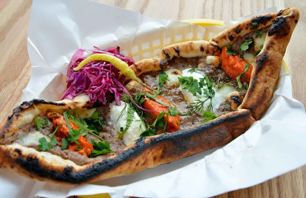 The pide features a choice of beef, chicken, veggie or cheese with ajvar, kajmak, herbs and cabbage salad. - TOM HELLAUER