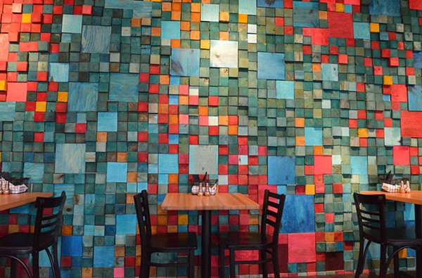Loryn Nalic and a friend sawed and colored over 2,000 pieces of wood to make this decorative wall. - TOM HELLAUER
