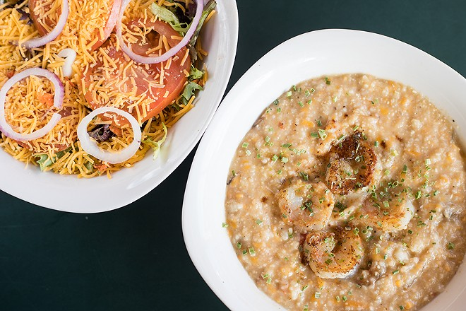 Shrimp and cheesy grits, shown here with a chef's salad, demonstrate Hourd-Bryant's skill at Southern cooking. - MABEL SUEN