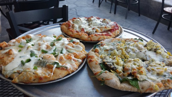 Get your pizza as a solo order — or indulge in a sampler flight with three eight-inch pies. - PHOTO BY SAMANTHA  DEVER