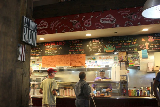 """The sign says """"eat more bacon,"""" but you could also just have a veggie sandwich. - PHOTO BY LAUREN MILFORD"""