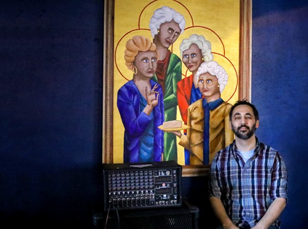 Co-Owner Jason Fossella poses proudly with a commissioned Golden Girls piece hung in the bar. - CHELSEA NEUING