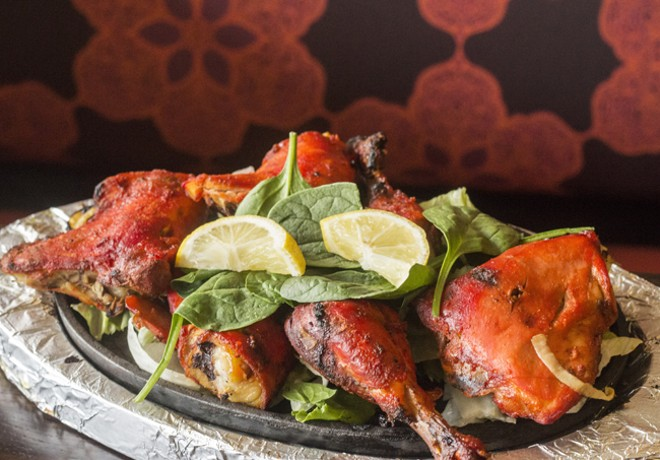 Tandoori chicken is marinated in fresh garlic, ginger, yogurt and spices. - MABEL SUEN