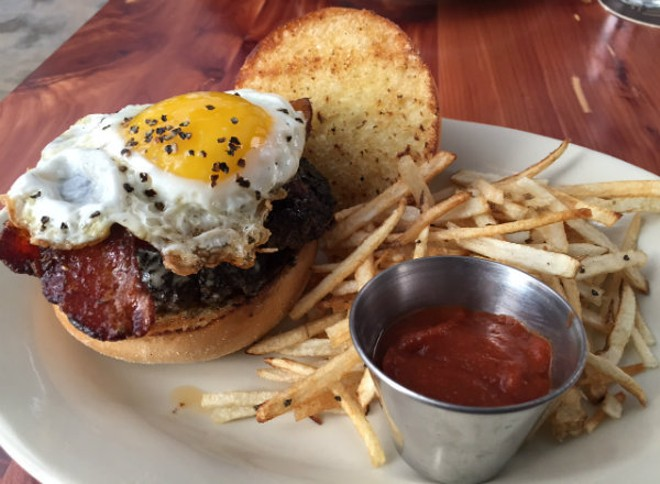 The Farmhouse Burger — two smashed patties, topped with bacon and a peppery eggs. - PHOTO BY SARAH FENSKE