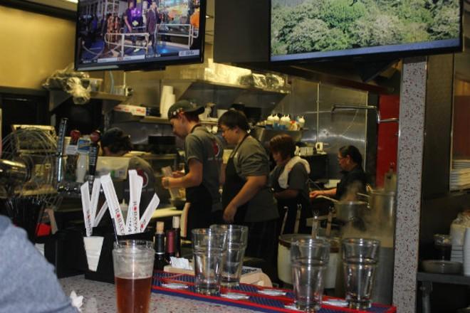 Cooks scramble on the line in Robata's tiny kitchen. - CHERYL BAEHR