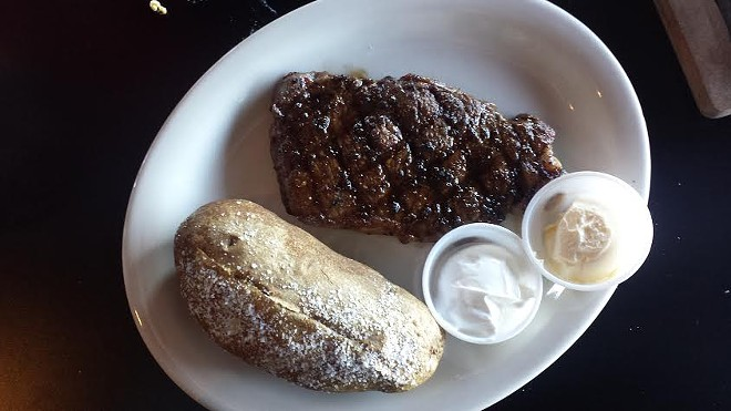 Frederick's steak, served with baked potato. - PHOTO BY SAMANTHA DEVER