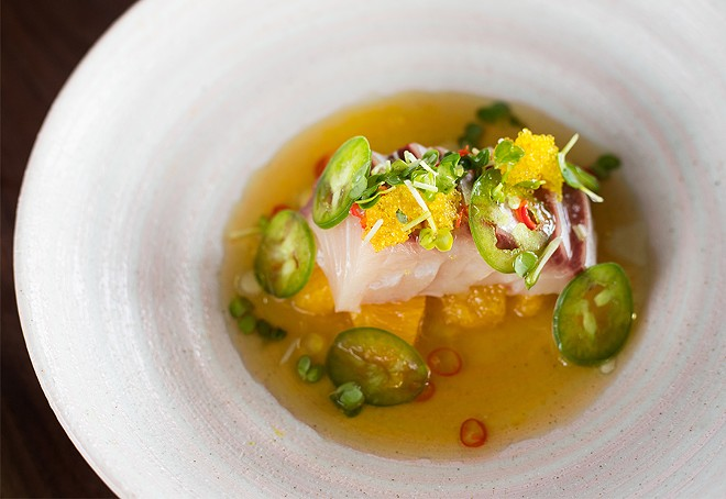 Hamachi crudo combines yellowtail with citrus and jalapeno. - MABEL SUEN