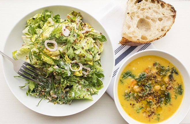"""The """"Little Gem"""" salad brings sourdough breadcrumbs, fine herbs and buttermilk dressing, while the kale and garbanzo soup is made with carrot, fennel and olive oil. - MABEL SUEN"""