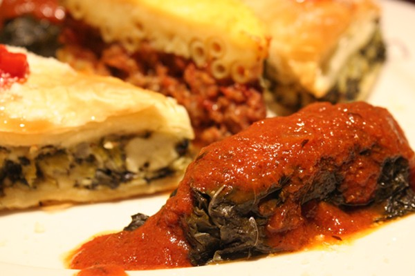 A combination platter with pastitio, dolmades and spinach pie. - JOHNNY FUGITT