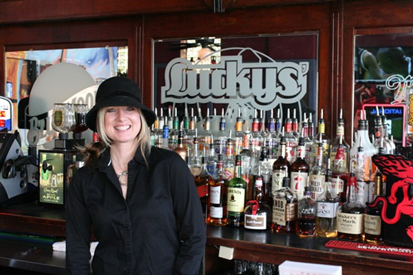 Bartender Faith is one of the friendly people pouring drinks at Luckys'. - JOHNNY FUGITT