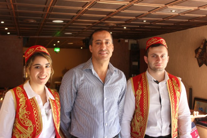 Owner Safa Marmarchi, center, with two servers at Sheesh Restaurant. - PHOTO BY SARAH FENSKE