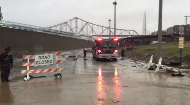 St. Louis firefighters had to rescue men on Monday from a tent encampment near a Leonore K. Sullivan Boulevard flood wall. - IMAGE VIA ST. LOUIS FIRE DEPARTMENT