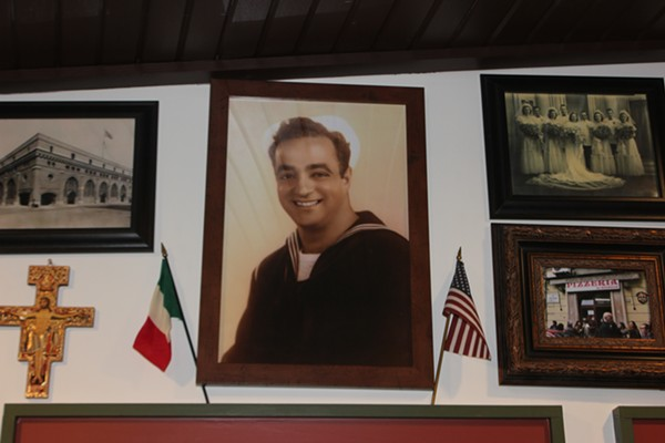 A portrait of the pizzeria's namesake, Carmelo Valenza, keeps watch over the place. - CHERYL BAEHR