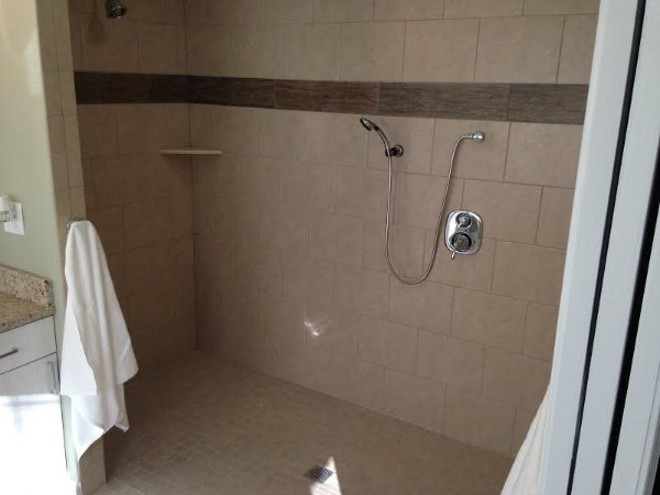 A new, wheel chair-friendly shower is part of a renovation to make Chris Sanna's new life easier. - DOYLE MURPHY