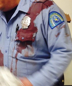 "After a tragic night, Don Re snapped this photo of an officer's bloodied uniform. ""This is what a good policeman looks like,"" he wrote on Facebook. - PHOTO COURTESY OF DON RE"