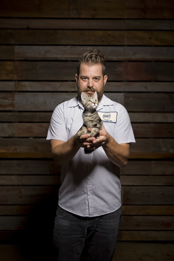 Communications manager Miah Smith is not only smoking hot, but he likes cats. Meow! - PHOTO BY KATE BURRUS