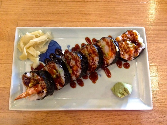 A shrimp tempura roll made with cucumber, avocado and eel sauce. - EMILY HIGGINBOTHAM