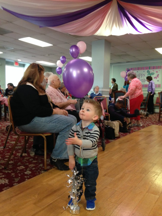 Mason Gibson, 19 months, chases balloons during a 108th birthday party for his great, great grandmother, Lucy Hamm. - PHOTO BY DOYLE MURPHY