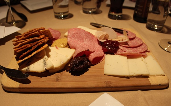 The charcuterie board offers local meats and cheeses and assorted preserves. - PHOTO BY LAUREN MILFORD