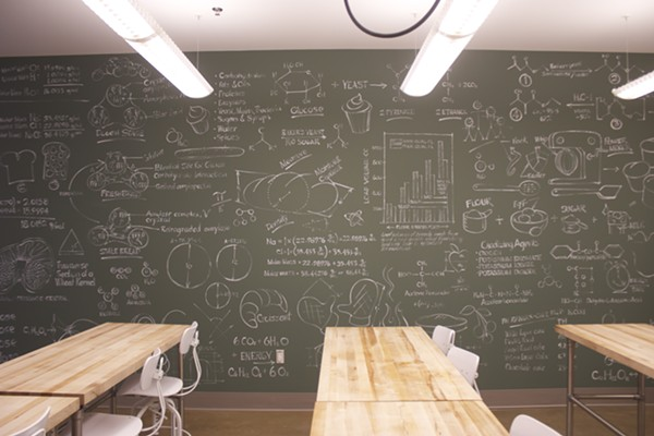 Chalk boards are covered with illustrations and diagrams. - PHOTO BY CHERYL BAEHR
