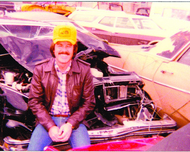Doc Nash in front of the Pontiac Grand Prix he totaled in 1981. - COURTESY OF THE MISSOURI ATTORNEY GENERAL