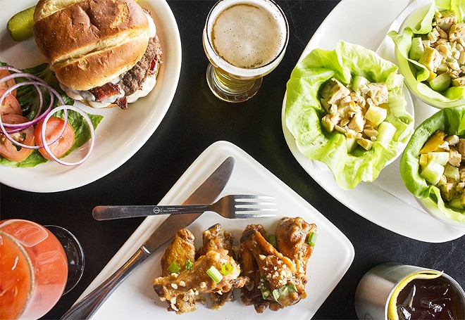 A selection of Brickyard Tavern dishes, including the burger, lettuce cups and whole wings. - PHOTO BY MABEL SUEN