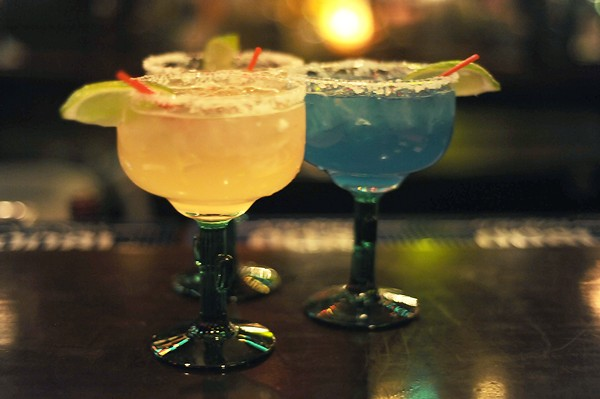 Margaritas at Pueblo Solis. For a twist, try the Blue Curacao. - PHOTO BY KELLY GLUECK
