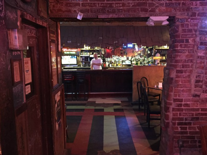 With brick walls and a dive-y feel, the bar at Black Thorn is often more crowded the dining room. - PHOTO BY DOYLE MURPHY