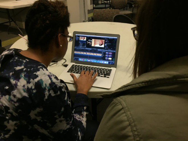 Desiree Westbrook, a Continuity student, receives instruction from Continuity teacher Jordan Schneider at Mission Video. - PHOTO COURTESY OF SEAN LOFTIN