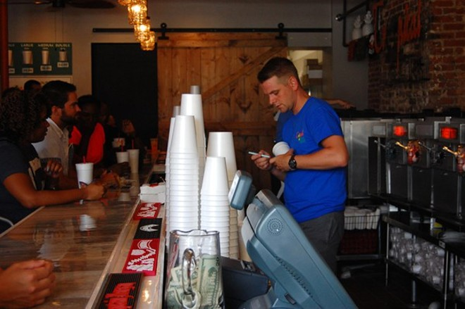 A bartender at Tropical Liqueurs' opening weekend in Soulard. - PHOTO BY KRISTIE MCCLANAHAN