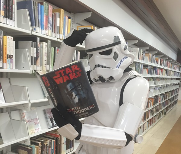 At last year's St. Louis Public Libraries comics convention, a storm trooper peruses the literature. - CREDIT TO RIVA STEWART