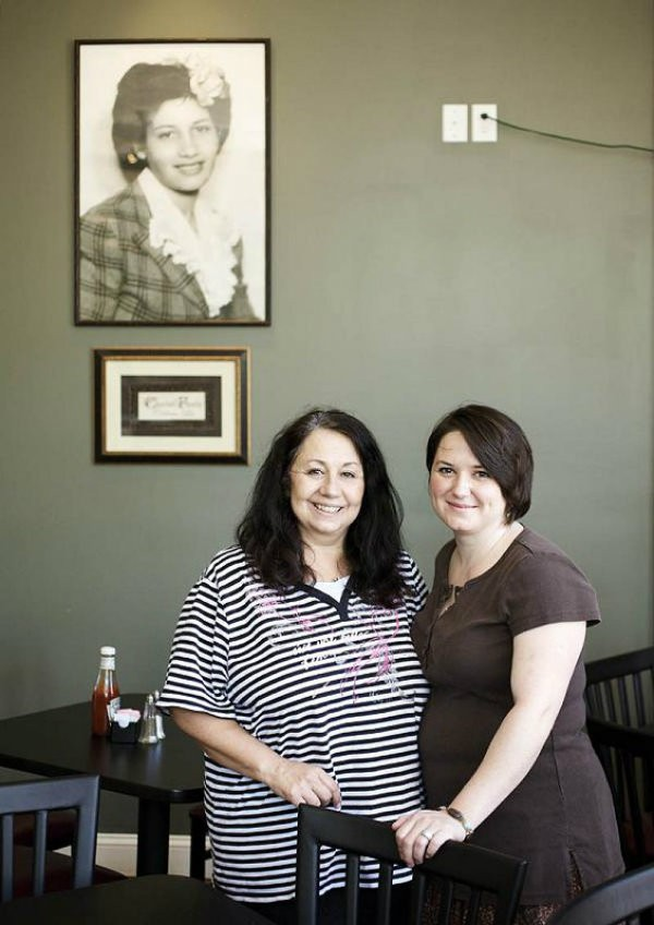 Mary Samuelson (left) and daughter Amy Keller (right) stand beneath a portrait of the restaurant's namesake. - JENNIFER SILVERBERG