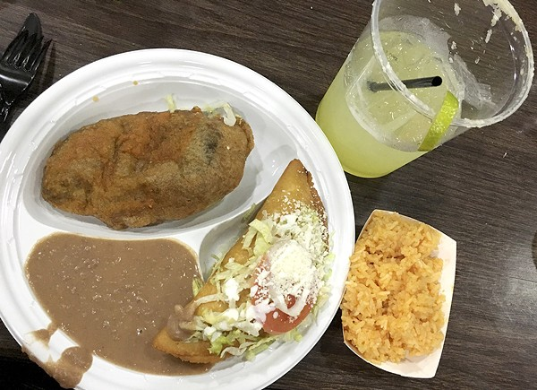 Two entrees, two sides — a fish fry the St. Cecilia way. - PHOTO BY KELLY GLUECK