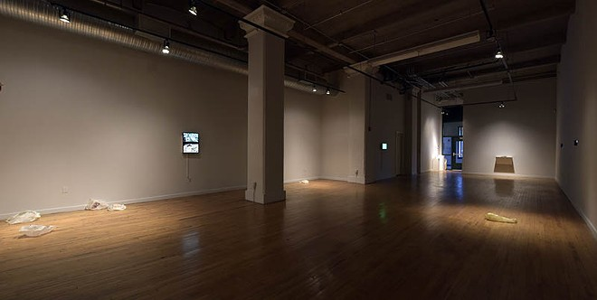 A scene of the Des Lee Gallery with Uncanny on display.