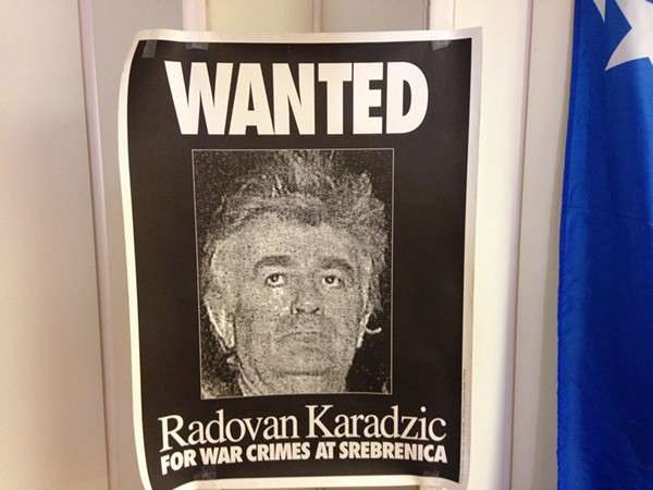 A wanted poster for Radovan Karadzic hangs on Thursday in the Bosnian Chamber of Commerce in St. Louis. - PHOTO BY DOYLE MURPHY