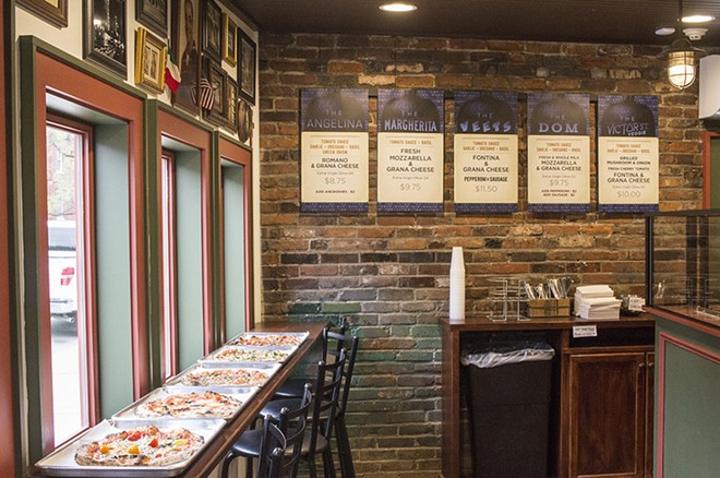 The interior of Melo's Pizzeria is tiny. - MABEL SUEN