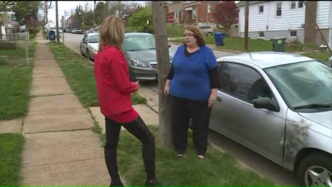 Marianne Power (right) tells Fox 2 reporter Erika Tallan about her run in with a dent repair con man. - IMAGE VIA FOX 2