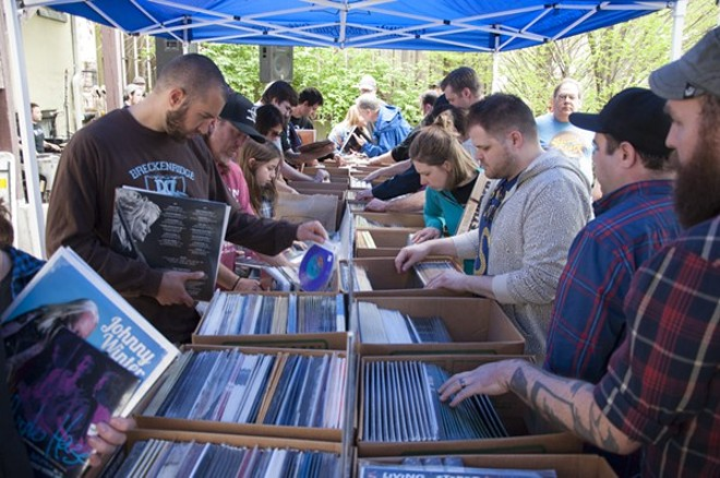 Eager shoppers paw through records at Euclid's outdoor tent at last year's Record Store Day party. - PHOTO BY MICAH USHER