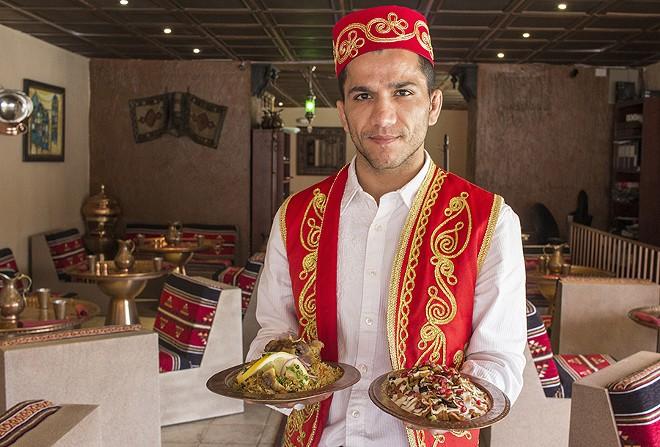 Servers wear formal Turkish dress. - PHOTO BY MABEL SUEN