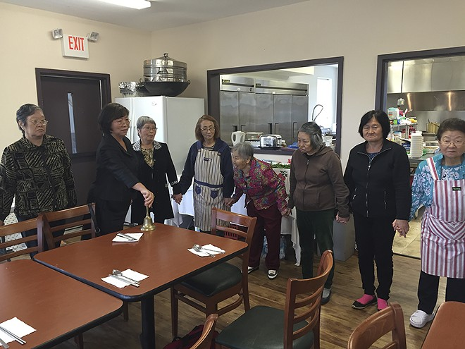 The women gather for a meal at the property in Robertsville. - PHOTO BY ERIC BERGER
