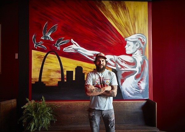 The bar features a Soviet-style mural by local artist Joe Albanese. - PHOTO BY STEVE TRUESDELL