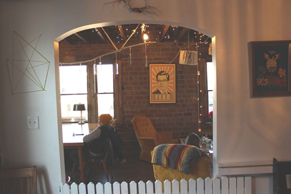 The wooden fence separates the children's space from another sitting area upstairs. - PHOTO BY LAUREN MILFORD