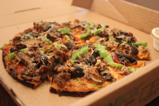 Pizza is also available to-go — and comes in an eco-friendly box that easily folds into plates. - PHOTO BY SARAH FENSKE