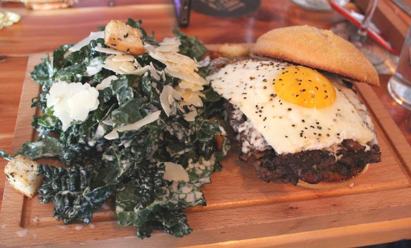 The farmhouse burger with kale Caesar salad. - PHOTO BY LAUREN MILFORD