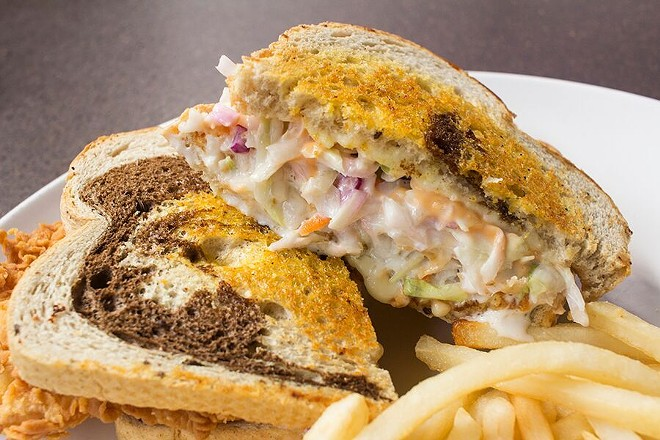 """The """"Grouper Reuben"""" is hand-battered, then deep-fried and topped with cole slaw, swiss cheese and 1000 Island dressing. - PHOTO BY MABEL SUEN"""