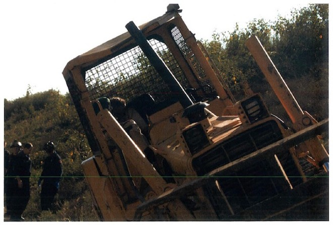 A photo from the scene of Bob Cassilly's death shows him in the bulldozer, which was found nearly upright with the artist's body slumped in the cage. - PHOTO COURTESY OF ALBERT WATKINS