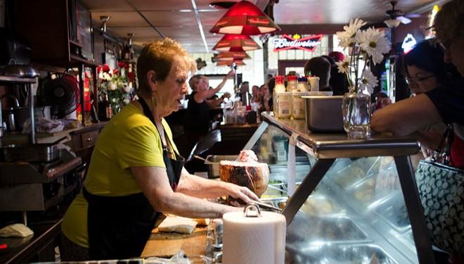Rose Garavaglia Lagates serves the last lunch at the Hilltop Inn on Friday, May 27. - KAVAHN MANSOURI