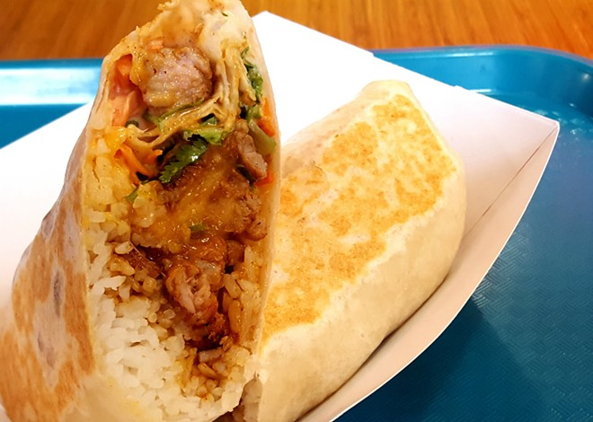Kalbi's Spicy Pork Burrito is one of the four variations of burritos offered at the shop. Each meal comes with an option of four different proteins: boneless beef short rib, sweet and spicy chicken, spicy pork and tofu. - KAVAHN MANSOURI