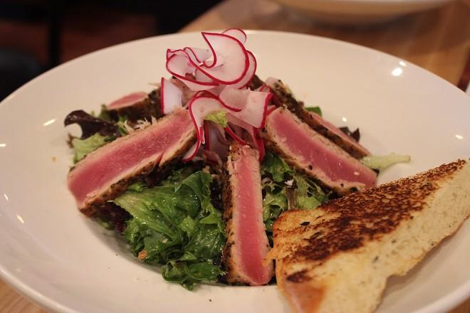 The sesame-crusted tuna salad comes topped with an orange-soy vinaigrette. - PHOTO BY SARAH FENSKE
