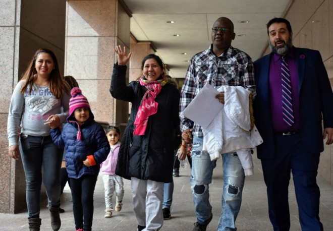 Ilsa Guzman-Fajardo (center) leaves the Robert A. Young Federal Building with her family and (far right) attorney, Javad Khazaeli. - DOYLE MURPHY